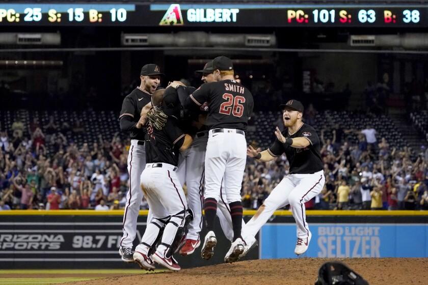 The Arizona Diamondbacks celebrate rookie left-hander Tyler Gilbert's no-hitter against the Padres