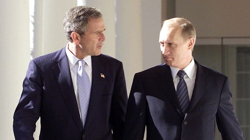 BUSH, PUTIN AGREE TO CUT NUCLEAR ARMS