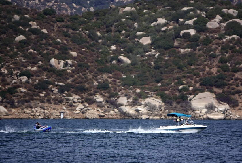 Boaters take to the water during a record-setting heat wave at San Vicente Reservoir.