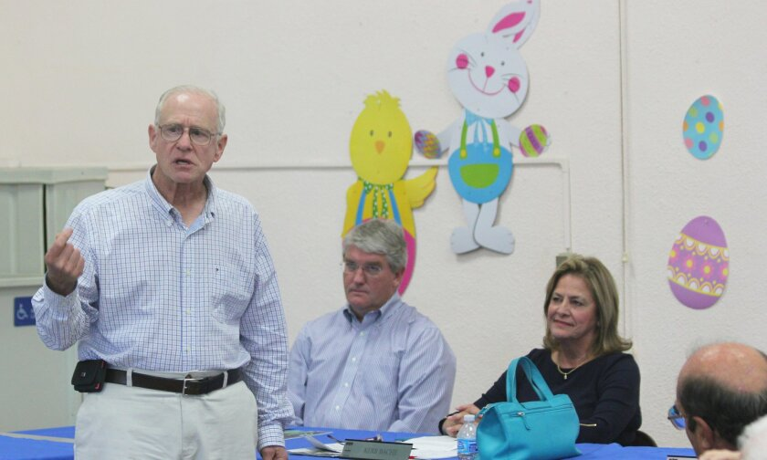 Former Town Council trustee Howard Singer says he is working to establish his own holiday parade this year with a faith-neutral title. Trustees Peter Wulff and Ann Kerr Bache, chair of the La Jolla Christmas Parade and Holiday Festival, look on.