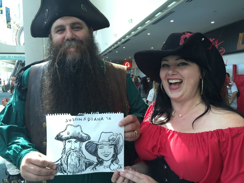 Union-Tribune editorial cartoonist Steve Breen sketches a couple on their honeymoon at Comic-Con.