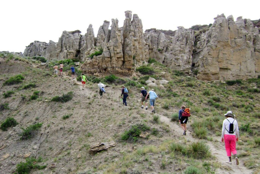 Hikers go up a hill by the Missouri River off the Lewis & Clark Trail.