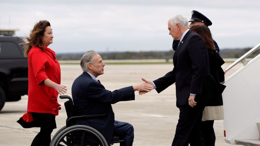 Texas Gov. Greg Abbott and his wife, Cecilia, left, welcome Vice President Mike Pence and his wife, Karen, to San Antonio.