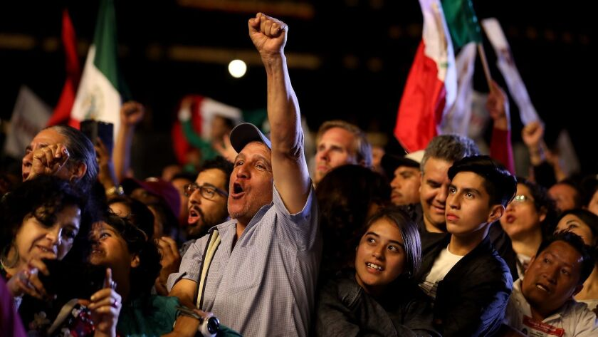 MEXICO CITY - - SUNDAY, JULY 1, 2018:— Mexicans wait for Andres Manuel Lopez Obrador to appear in
