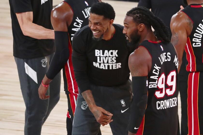 Miami Heat forward Udonis Haslem, center, and forward Jae Crowder (99) celebrate their win.