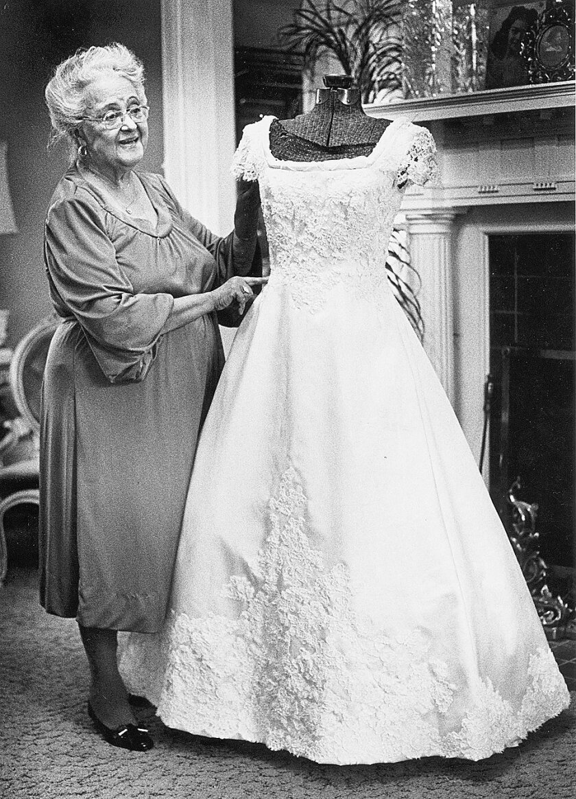 """In this shown in this 1981 photo, Willie Otey Kay shows her dress form in her living room at her house on New Bern Avenue in Raleigh, N.C., as she crafted the specialty dresses. Long before the rage over a must-have Marc Jacobs handbag or a pair of 7 For All Mankind jeans, """"it"""" girls in the Triangl"""