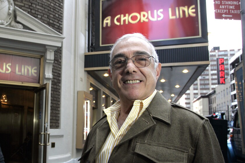 """Choreographer Bob Avian stands outside the Gerald Schoenfeld Theatre on Broadway under a marquee for """"A Chorus Line"""" in 2006"""