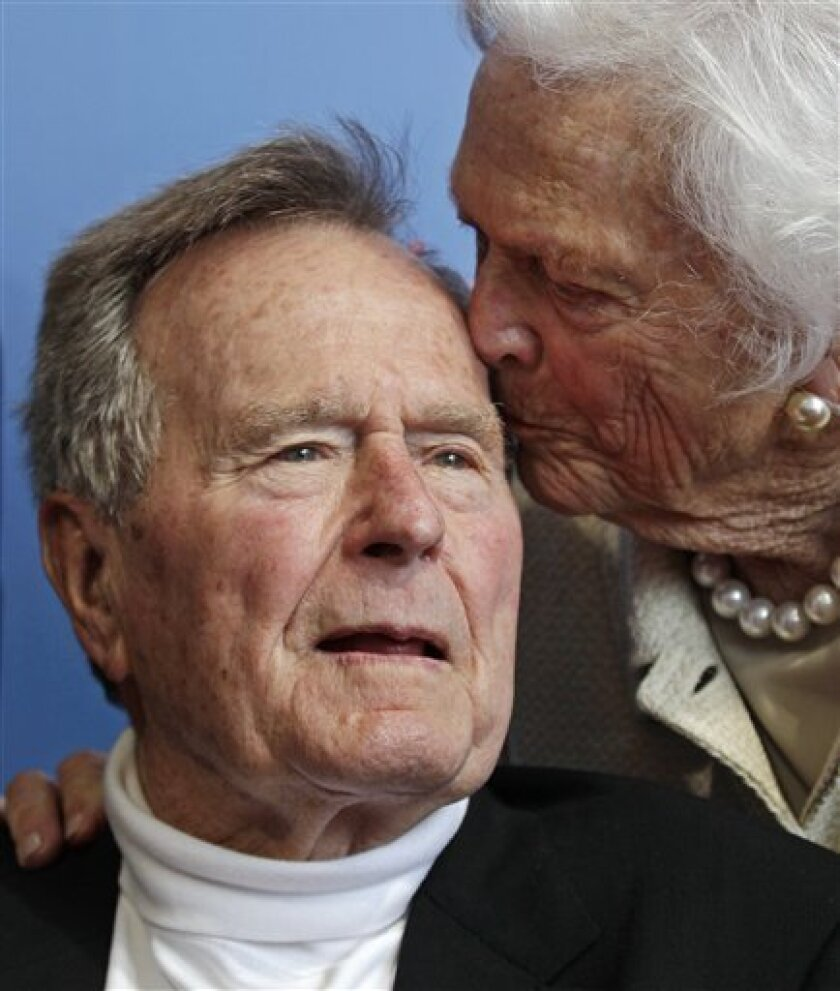 FILE - In a Tuesday, June 12, 2012 file photo, former President George H.W. Bush, and his wife former first lady Barbara Bush, arrive for the premiere of HBO's new documentary on his life near the family compound in Kennebunkport, Maine. Former President Bush has been hospitalized for about a week in Houston for treatment of a lingering cough. Bush's chief of staff, Jean Becker, says the 88-year-old former president is being treated for bronchitis at Houston's Methodist Hospital and is expected to be released by the weekend. He was admitted Friday, Nov. 23, 2012. (AP Photo/Charles Krupa, File)