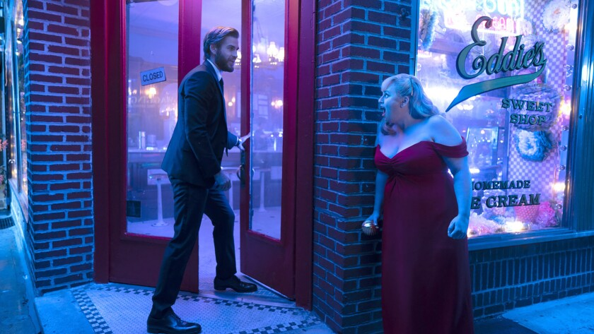 "Liam Hemsworth and Rebel Wilson in the movie ""Isn't It Romantic."""