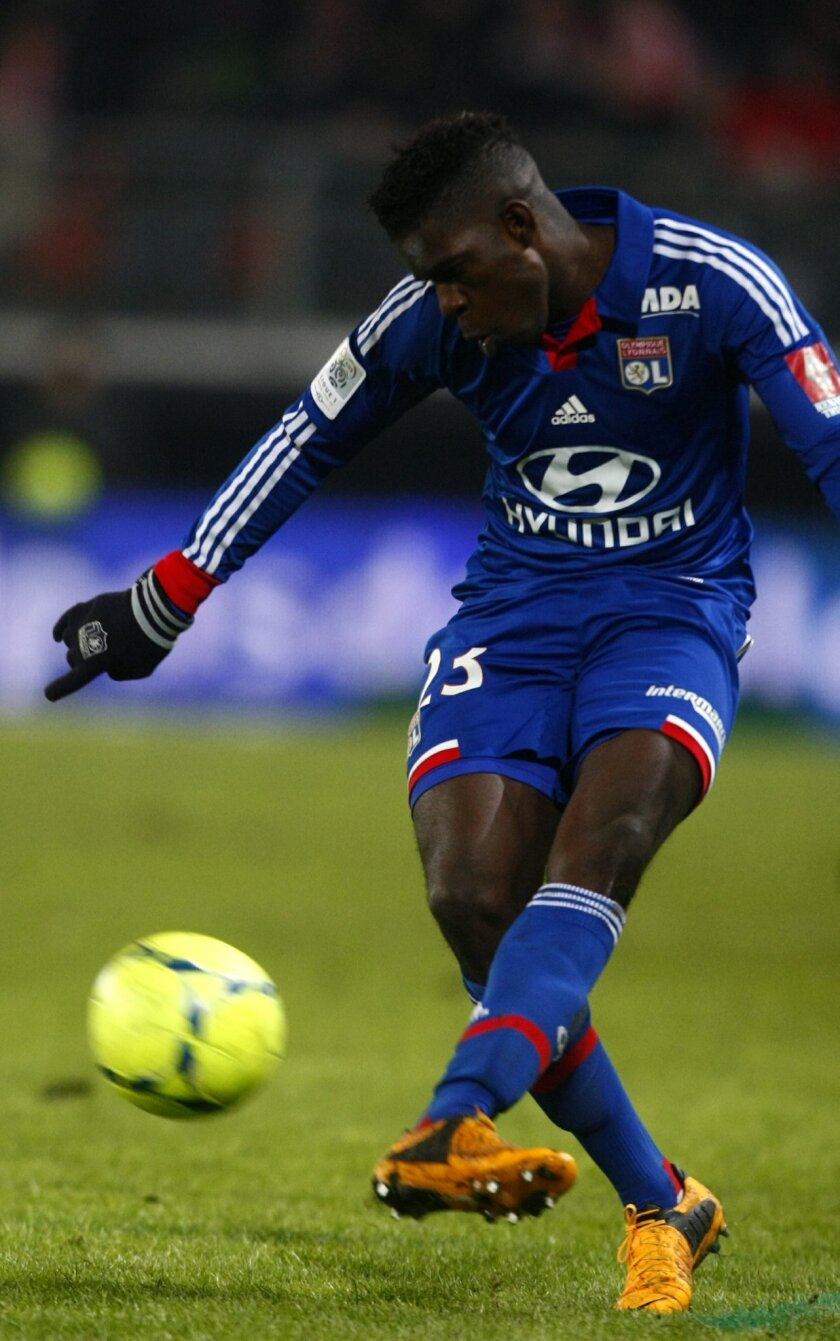 FILE - In this Friday, Jan. 25, 2013 file photo, Lyon's defender Samuel Umtiti, kicks the ball during a French League one soccer match in Valenciennes, northern France. Many nations are betting on youth at the European Championship, giving promising youngsters a chance to breakthrough in France. So