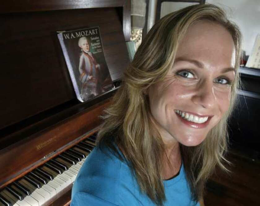 Boxer, body builder, pianist, actor, physical trainer Dallas Malloy at her home in Los Angeles on Tuesday, September 20, 2011. (Tim Berger/Staff Photographer)