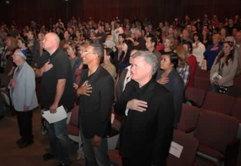 Attendees of a pray-for-peace event fill the Sherwood Auditorium at Museum of Contemporary Art San Diego in La Jolla on Nov. 20. Photos by Pat Sherman