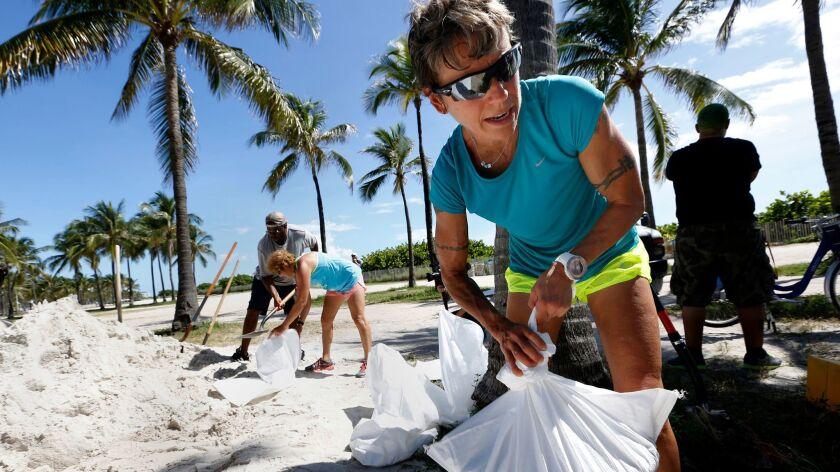 Andrea Ratkovic, 51, of Norman, Okla., helps make sandbags Sept. 7 in Miami Beach.