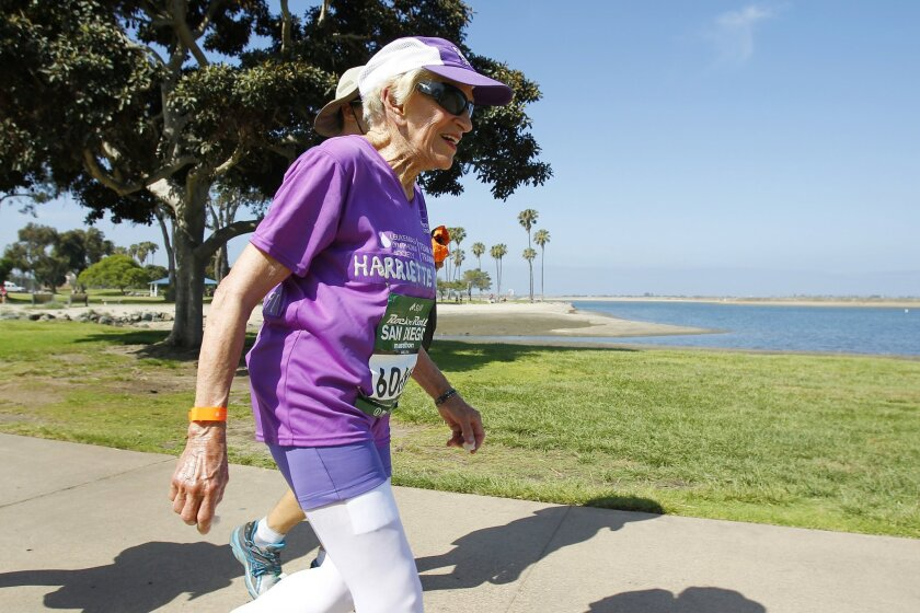 Harriette Thompson, 91, runs near Mission Bay in the San Diego Rock 'n' Roll Marathon.