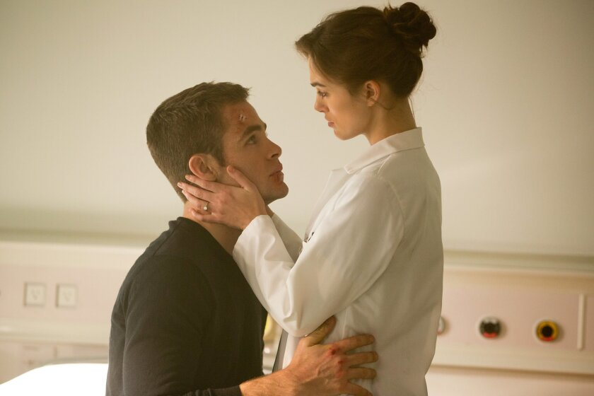 """This image released by Paramount Pictures shows Keira Knightley, right, and Chris Pine in """"Jack Ryan: Shadow Recruit,"""" an action thriller about a covert CIA analyst who uncovers a Russian plot to crash the U.S. economy with a terrorist attack. (AP Photo/Paramount Pictures, Larry Horricks)"""