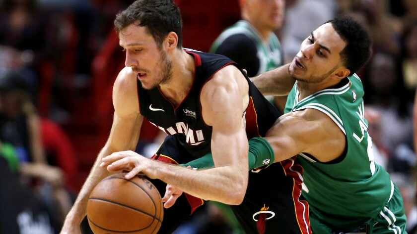 Celtics guard Shane Larkin attempts to steals the ball from Heat guard Goran Dragic during the second half Wednesday.
