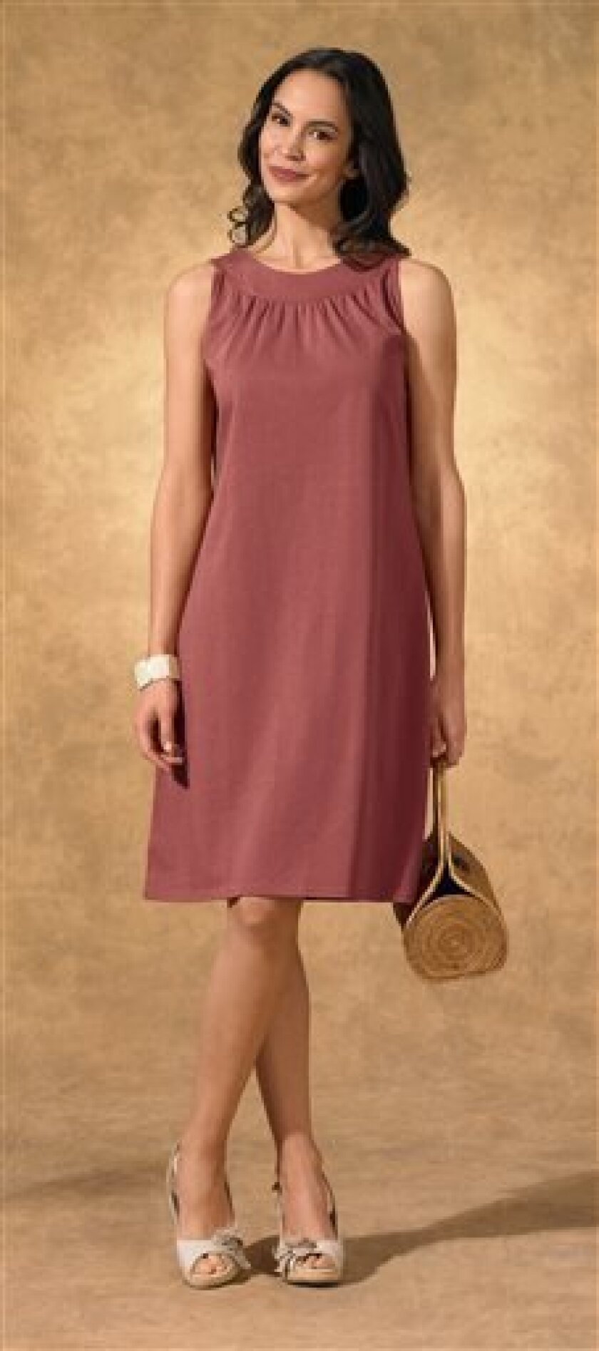 This undated product image provided by Fair Indigo shows one of the company's product. Fair Indigo is an online retailer that sells clothes and accessories that are certified by Fair Trade U.S.A., including $59.90 pima organic cotton dresses, $45.90 faux wrap skirts and $100 floral ballet flats. (A