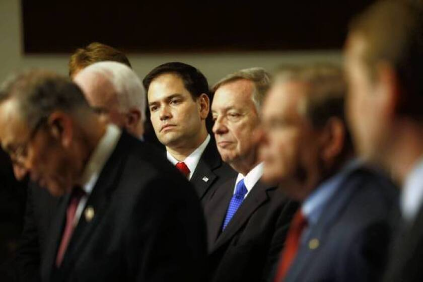 Sen. Marco Rubio (R-Fla.), center, and other senators attend a news conference on immigration at the Capitol. He has long insisted that the immigration bill's border security provisions are not strong enough to win significant Republican support.