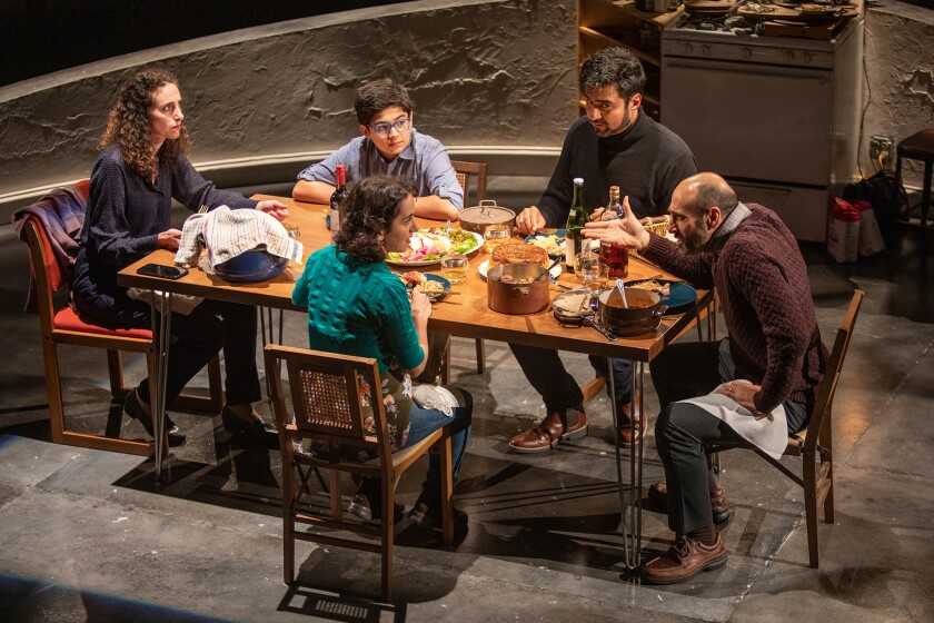 "The cast of ""Noura"" at The Old Globe, from left: Lameece Issaq as Noura/Nora, Giovanni Cozic as Yazen/Alex, Isra Elsalihie as Maryam, seen from behind, Fajer Kaisi as Rafa'a, and Mattico David as Tareq/Tim."