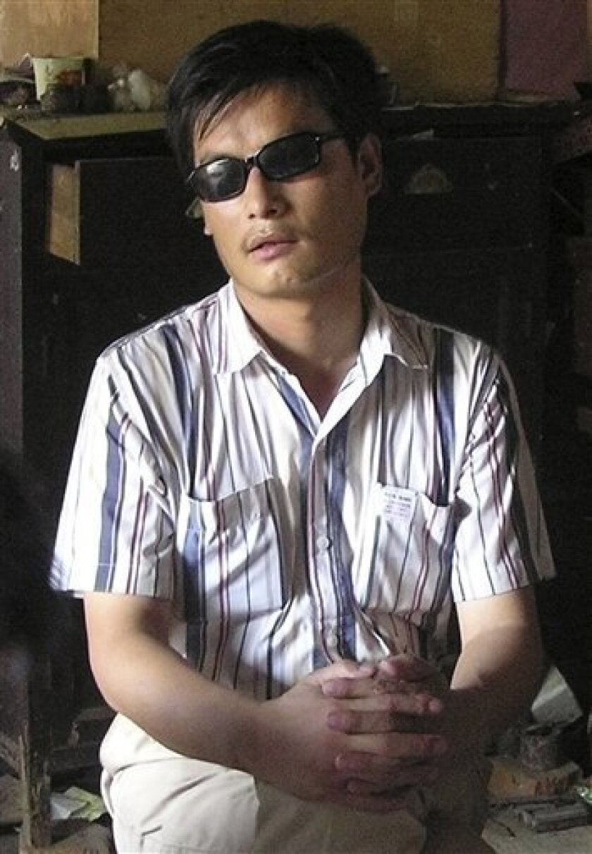 FILE - In this undated file photo released by his supporters, blind activist Chen Guangcheng sits in a village in China. Police prepared Wednesday, Sept 8, 2010, for the release from prison of the blind, self-taught activist lawyer in much the same way they treated him before his jailing four years ago: putting his family under surveillance and ringing his rural east China home with plainclothes security. (AP Photo/Supporters of Chen Guangcheng, File)