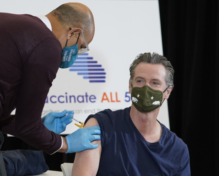 California Gov. Gavin Newsom gets vaccinated.