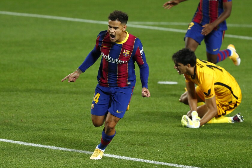 Barcelona's Philippe Coutinho celebrates scoring the opening goal during the Spanish La Liga soccer match between FC Barcelona and Sevilla FC at the Camp Nou stadium in Barcelona, Spain, Sunday, Oct. 4, 2020. (AP Photo/Joan Monfort)