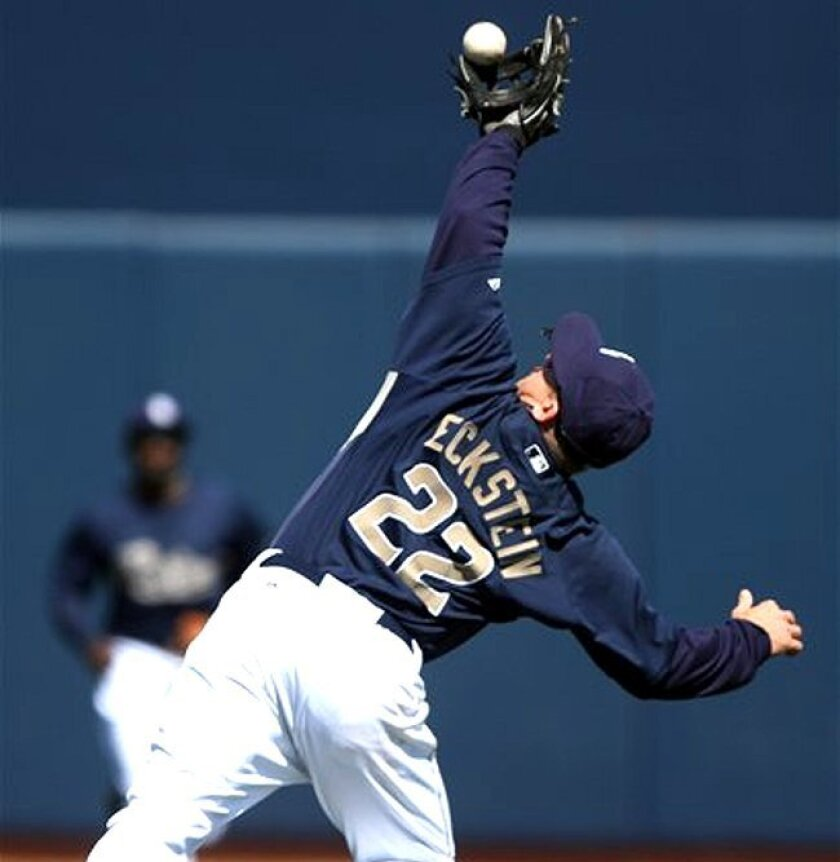 Padres second baseman David Eckstein robs the Brewers' Gregg Zaun of hit while making a leaping over-the-shoulder catch in the second inning of a spring training game Wednesday, March 10, in Peoria, Ariz.