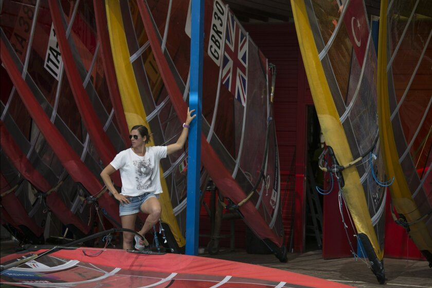Marina Alabau, a Spanish windsurfer and a gold medalist at London Olympics, stands by her surf borads in Eliat, Israel, Friday, Feb. 19, 2016 as she prepares for the RS:X World Championship. Alabau said she got Zika while training in Brazil in December, making her possibly the first Olympic athlete