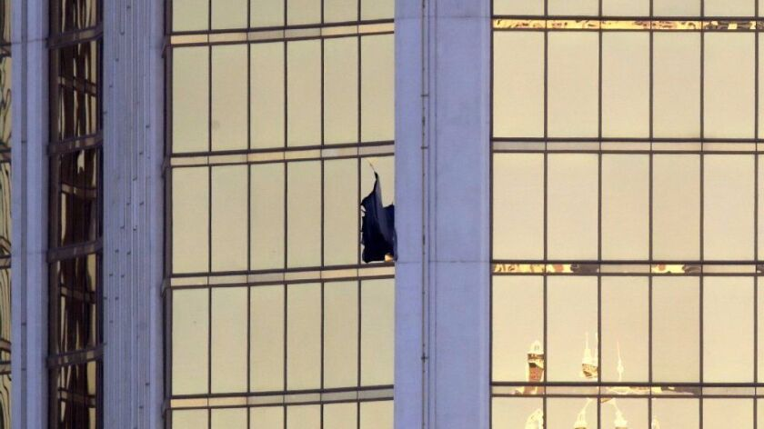 A broken window is seen at the Mandalay Bay Resort and Casino on Oct. 2 on the Las Vegas Strip.