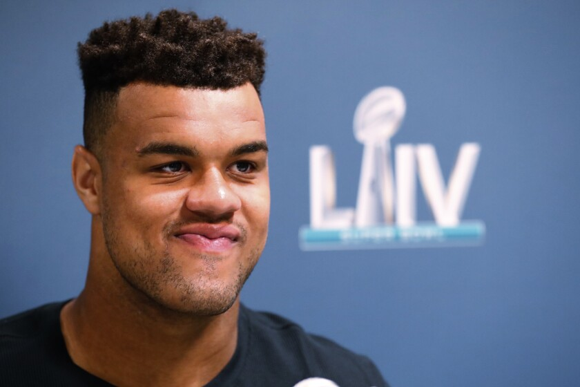 FILE - San Francisco 49ers defensive end Arik Armstead speaks during a media availability for the NFL Super Bowl 54 football game, on Tuesday, Jan. 28, 2020, in Miami. Armstead is making the most of his media obligations this season by using that time to highlight issues of social justice that are important to him. (AP Photo/Wilfredo Lee, File)