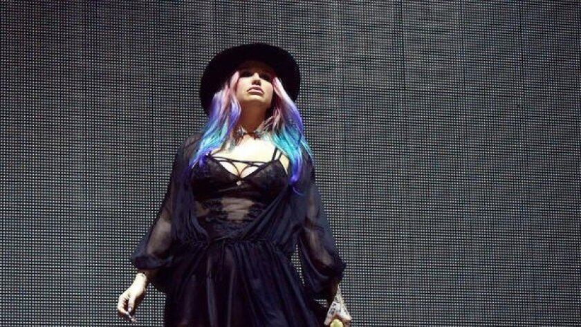 Singer Kesha performs onstage with record producer Zedd during Day 2 of the 2016 Coachella Valley Music & Arts Festival Weekend 1 on April 16, 2016, in Indio.