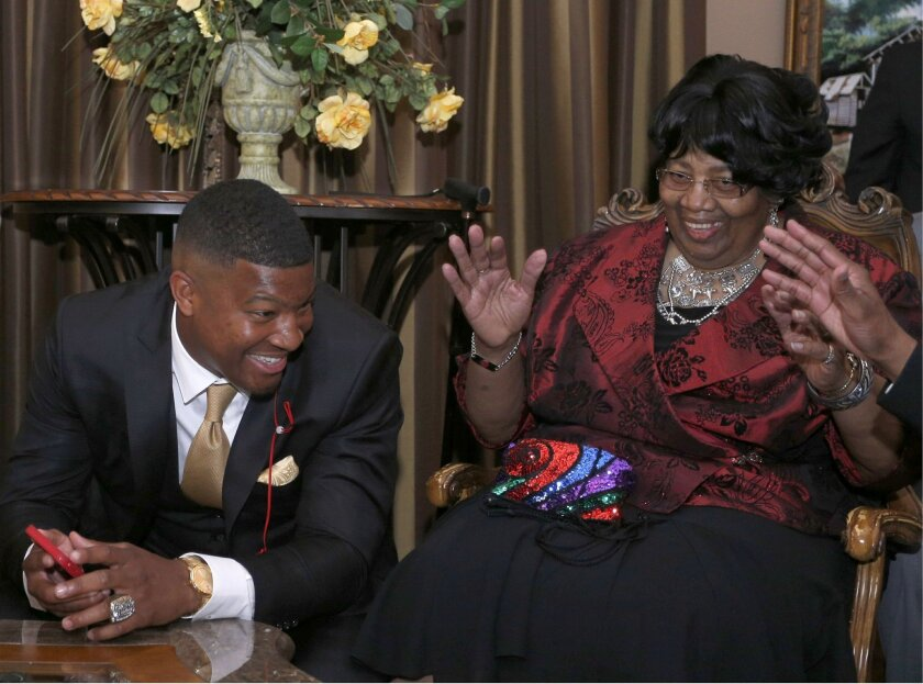 James Winston reacts with his grandmother Myrtle Winston to learning he is the first pick in the NFL draft Thursday, April 30, 2015 in Bessemer, Ala. Winston was drafted by the Tampa Bay Buccaneers. (AP Photo/Hal Yeager)