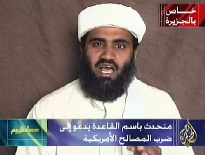 "This image monitored from the Qatar-based satellite TV station al Jazeera shows the spokesman of Osama bin Laden's Al Qaeda network, Sulaiman Abu Ghaith, reading a pre-recorded message broadcast by the television station on Oct. 9, 2001. Abu Ghaith urged ""all Muslims"" to join in a jihad against the United States. His attorneys contend the U.S. has charged the wrong man."