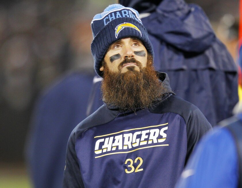 Chargers Eric Weddle watches from the sideline in the 2nd half against the Raiders.