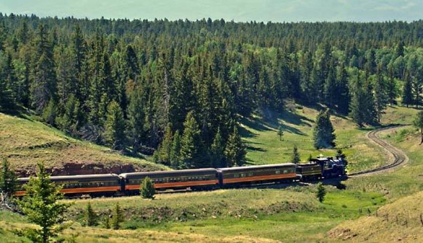 A steam locomotive chugs from the concert site at La Veta Pass.