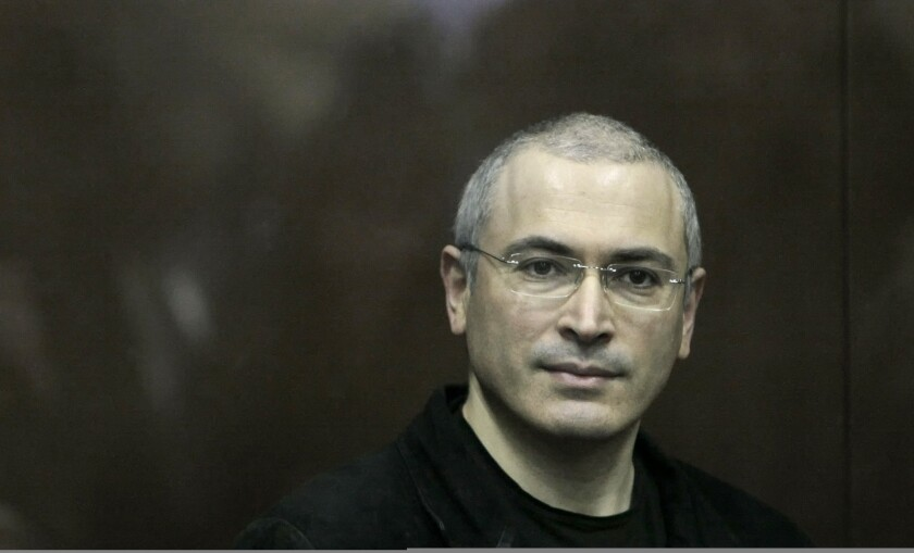 Mikhail Khodorkovsky looks on from behind a glass enclosure in a Moscow courtroom in  2010.