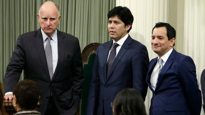 California Gov. Jerry Brown, Senate President Pro Tem Kevin de León, D-Los Angeles, and Assembly Speaker Anthony Rendón, D-Paramount, are seen at the Capitol in Sacramento on March 7.