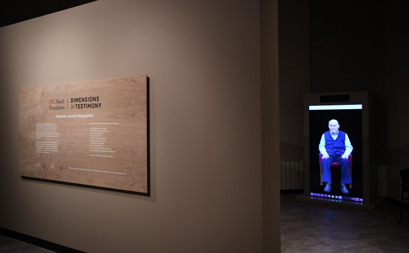 """The interactive video installation """"Dimensions in Testimony"""" at the exhibition """"Facing Survival"""" at the USC Fisher Museum of Art."""