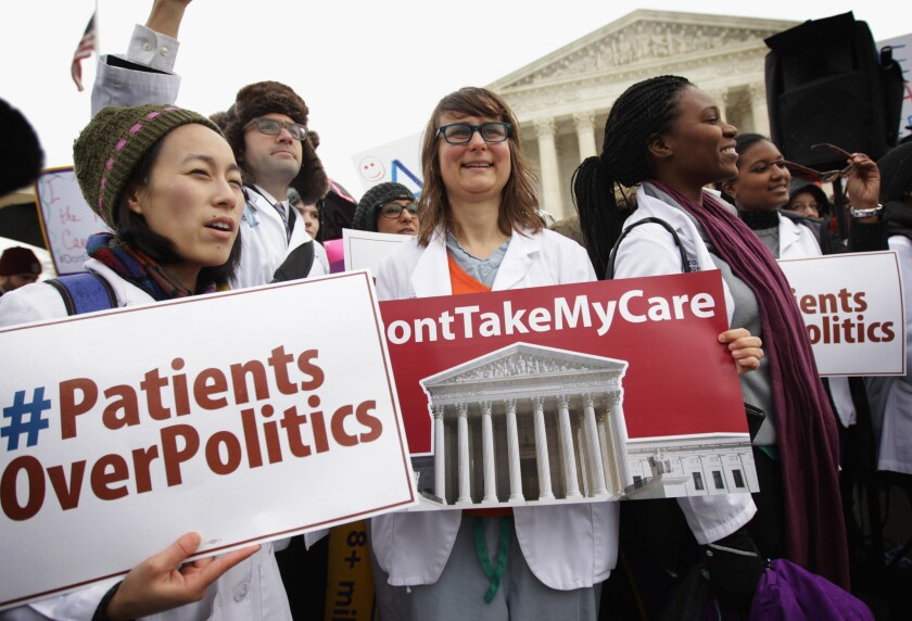 Supporters of the Affordable Care Act gather in front of the U.S Supreme Court in March to urge Justice not to overturn subsisies.