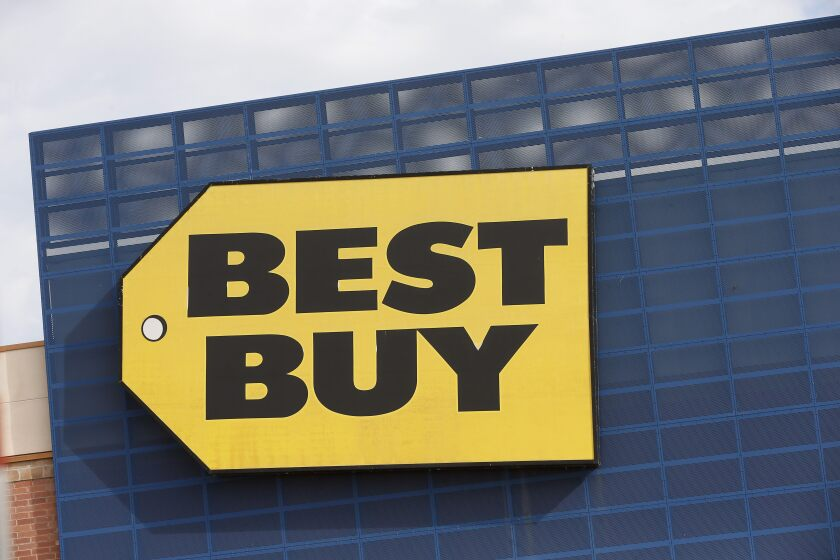 FILE - In this Aug. 27, 2019, file photo, the Best Buy logo is shown on a store in Richfield, Minn. Best Buy Co., the nation's largest consumer electronics chain, says it plans to expand its remote monitoring services of seniors to 5 million from 1 million in five years. (AP Photo/Jim Mone, File)