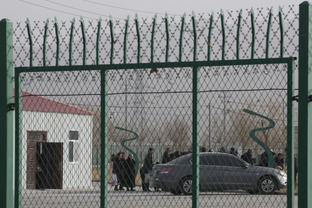 Residents line up at a site reported to be an indoctrination camp in Xinjiang, China.
