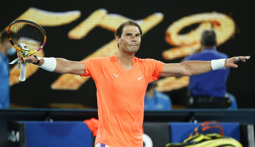 Spain's Rafael Nadal celebrates after defeating United States' Michael Mmoh during their second round match at the Australian Open tennis championship in Melbourne, Australia, Thursday, Feb. 11, 2021.(AP Photo/Rick Rycroft)