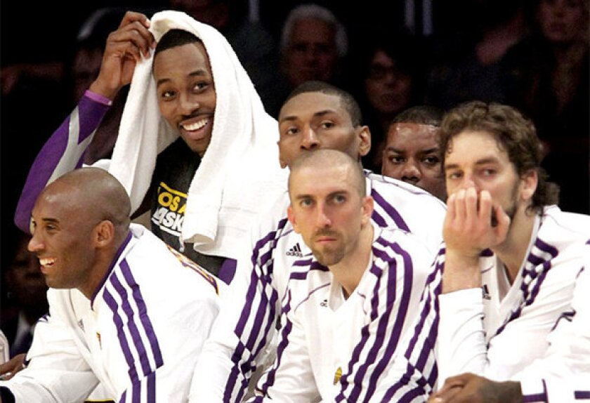 The Lakers' Kobe Bryant, left, Metta World Peace, Steve Blake or Pau Gasol could be amnestied. Dwight Howard (background) can sign with the Lakers for five years at $118 million.