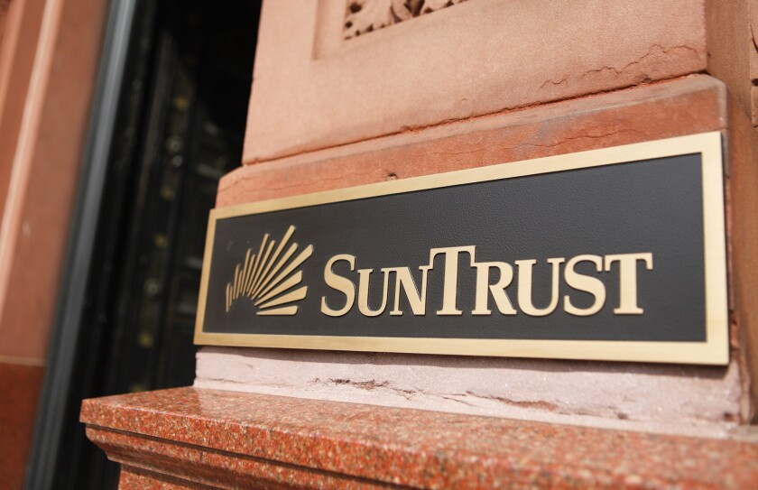 State and federal authorities have reached a settlement with SunTrust Mortgage, the home-lending arm of SunTrust Banks Inc. Above, a SunTrust branch in Washington, D.C.