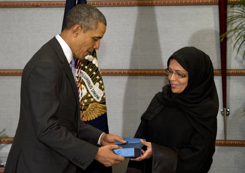President Obama presents Dr. Maha Al Muneef, a human rights advocate, with the Secretary of State's International Women of Courage Award in Riyadh.