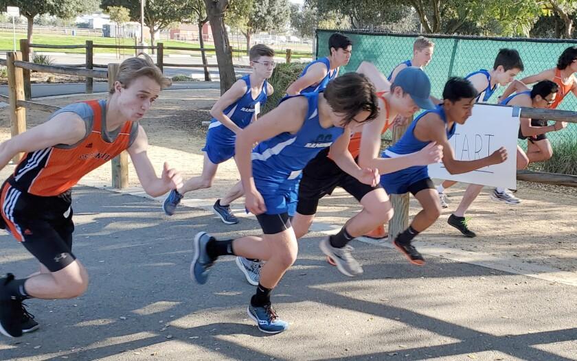 Ramona High's Junior Varsity boys cross-country team begin their race at Escondido on Feb. 11.