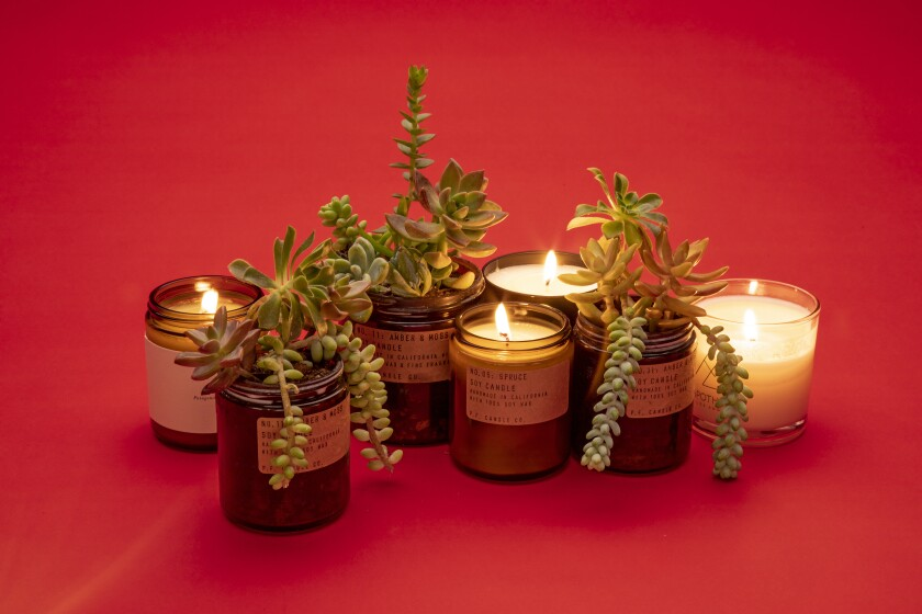 Create instant holiday magic with these aromatic winter candles. When you're done, turn the glass container into a planter and offer it as a hostess gift.
