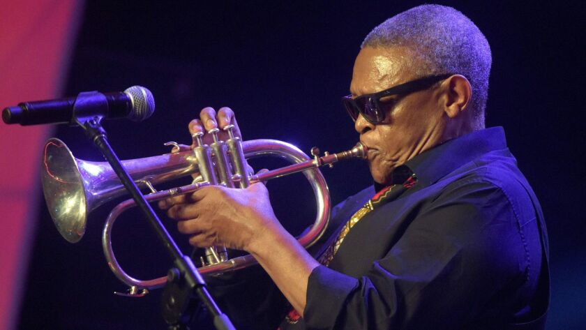 South African jazz musician Hugh Masekela plays the flugelhorn at the Confederation of African Football awards in Lagos, Nigeria, in 2015.