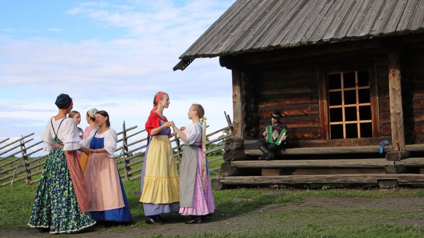 Locals in period costumes are part of the backdrop of Kizhi Island, a rural open-air museum featurin
