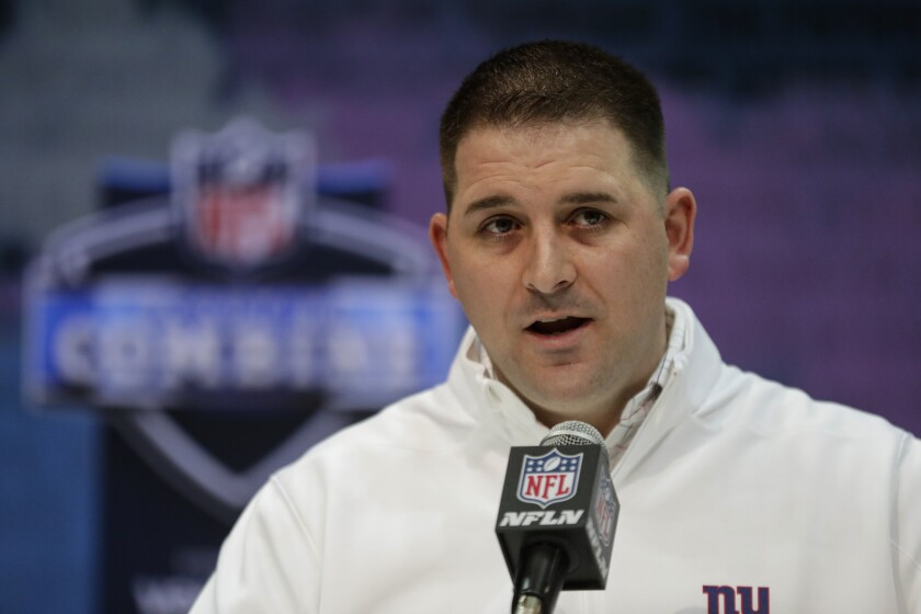 FILE - In this Tuesday, Feb. 25, 2020, file photo, New York Giants head coach Joe Judge speaks during a press conference at the NFL football scouting combine in Indianapolis. As the Giants and new coach Joe Judge get ready for their first training camp practice on Monday, Aug. 17, the one certainty is recent free agent signee James Bradberry will be one of the cornerbacks. The former Carolina Panther is one of the best in the league and gives New York a lock-down guy.(AP Photo/Michael Conroy, File)